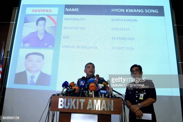 Royal Malaysian Police chief Khalid Abu Bakar addresses journalists in front of a screen displaying the details of North Korean Embassy staff Hyon...