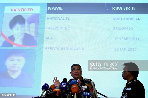 Royal Malaysian Police chief Khalid Abu Bakar addresses journalists in front of a screen displaying the details of a North Korean Airlines employee...