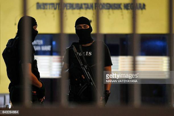 Royal Malaysian Police Special Forces personnel stand guard inside the compound of the forensic wing at Hospital Kuala Lumpur in the early hours of...