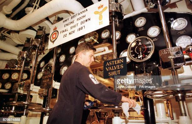 Royal marine engineer mechanic Simon Field from Middlesbrough cleans the engine room on board the Royal Yacht Britannia before her payingoff ceremony...