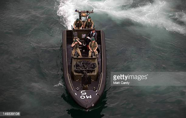 Royal Marines and police leave RFA Mount Bay as they patrol Weymouth bay ahead of the start of the London 2012 Olympics on July 27 2012 in Portland...