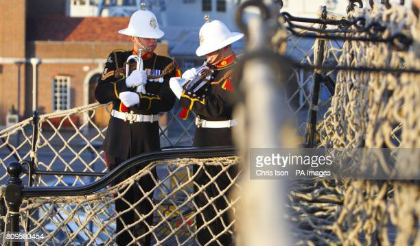 Royal Marine's Band buglers on the deck of HMS Victory prepare to mark the 206th anniversary of victory at the Battle of Trafalgar and the death of...