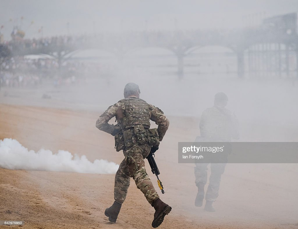 Royal Marines Commando's take part in a beach assault demonstration during the Armed Forces Day National Event on June 25, 2016 in Cleethorpes, England. The visit by the Prime Minister came the day after the country voted to leave the European Union. Armed Forces Day is an annual event that gives an opportunity for the country to show its support for the men and women in the British Armed Forces.