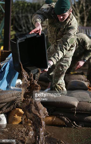 Royal Marines from 40 Commando help bail out a property in Moorland as they help with flood defences on the Somerset Levels near Bridgwater on...