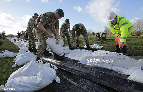 Royal Marines from 40 Commando help build a sandbag wall around a property in Moorland as they help with flood defences on the Somerset Levels near...