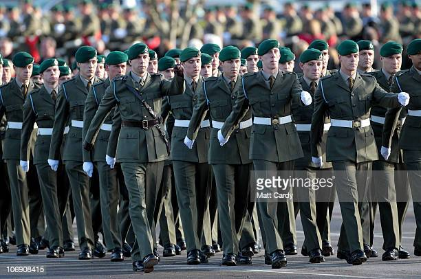 Royal Marines from 40 Commando march out of the parade ground after being presented with their campaign medals following a sixmonth deployment in...