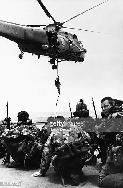 Royal Marines from 40 Commando troop await transport from the deck of the HMS Hermes onto the Sea King helicopters enroute to the Falklands Islands