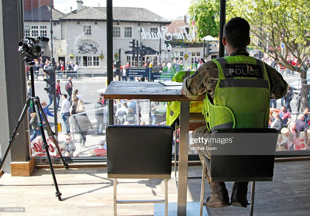 A Royal Military Policeman mans the police Duty Room in the town centre before the Babcock Trophy rugby union match between The British Army and the Royal Navy played in Twickenham Stadium, on April 30, 2016 in Twickenham, England.