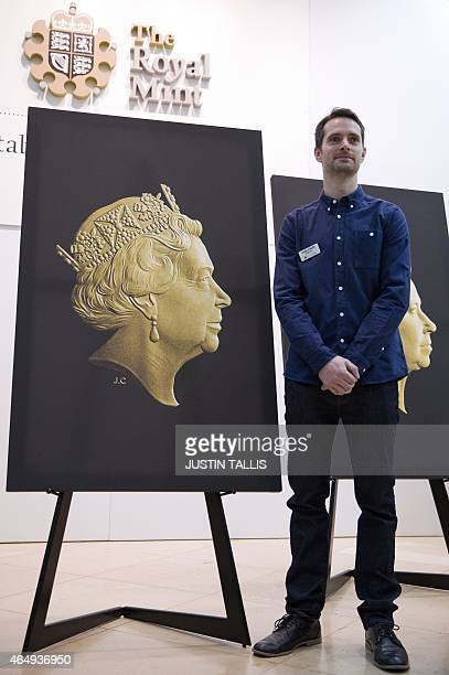 Royal Mint engraver Jody Clark poses for photographers next to the new coin portrait of Britain's Queen Elizabeth II at the National Portrait Gallery...