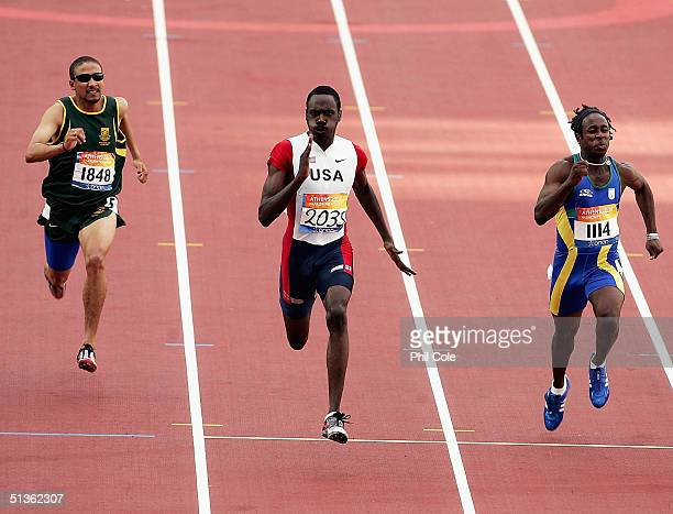 Royal Mitchell of the USA wins the Final of the 100mT13 for Men at the Athens 2004 Paralympic Games at the Olympic Stadium on September 27 2004 in...