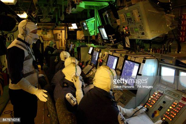 Royal Naval personnel go through a war exercise in the Operations Room of the HMS Ocean