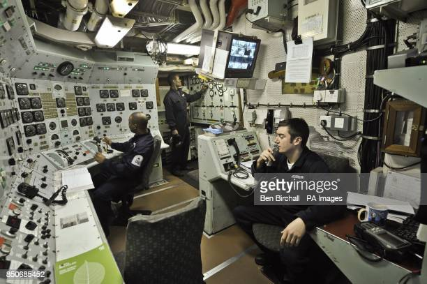 Royal Navy Mechanical Engineers in the Engineering Control Room aboard HMS Edinburgh during the ship's farewell tour of the UK heading for Leith...