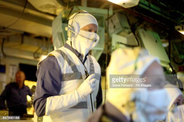 Royal Navy personnel practice in the operations room onboard HMS Ocean as the ship heads towards Greenwich London for a major security exercise in...