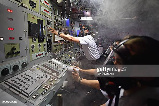 Royal Navy personnel respond to a fire in a control room of a Vanguard Class ship simulator at Her Majesty's Naval Base Clyde on January 20 2016 in...