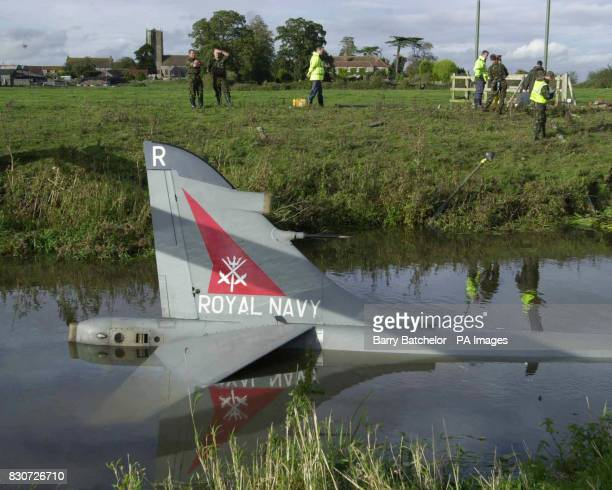A Royal Navy Sea Harrier in the River Yeo close to Royal Navy Air Station Yeovilton Somerset The plane was coming into land at thebase but failed to...