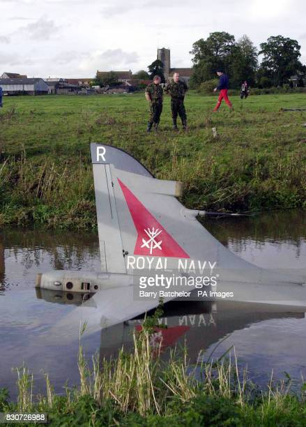 A Royal Navy Sea Harrier partially submerged in a river close to Royal Navy Air Station Yeovilton Somerset The plane was coming into land at thebase...