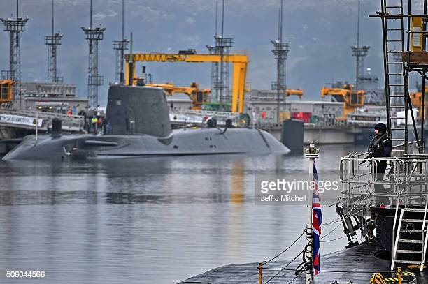 Royal Navy security personnel stand guard on HMS Vigilant at Her Majesty's Naval Base Clyde on January 20 2016 in Rhu Scotland HMS Vigilant is one of...