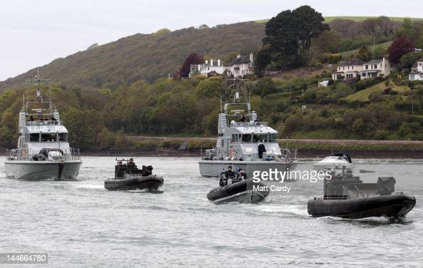 Royal Navy vessels that have been training at the Britannia Royal Naval College rehearse their role in the Thames Diamond Jubilee Pageant on May 17...