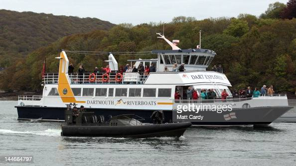 Royal Navy vessels that have been training at the Britannia Royal Naval College surround the passenger ferry Dart Explorer as it substitutes the...