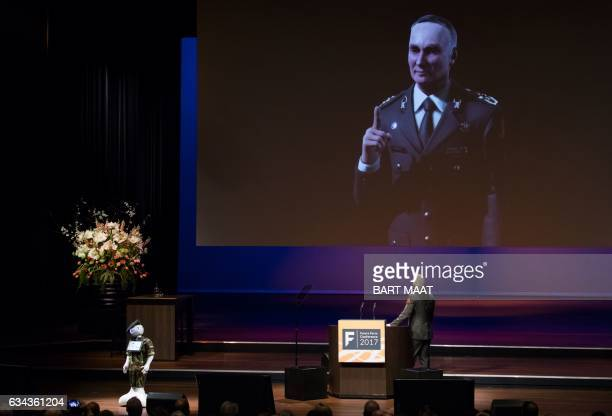 Royal Netherlands Army general Tom Middendorp looks at a large screen with an animation as he holds the opening speech for the Future Force...