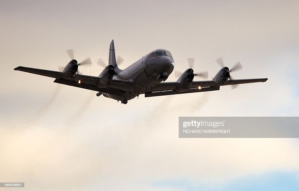 A Royal New Zealand Air Force P3 Orion takes off from RAAF Pearce Airbase in Bullsbrook 35 kms north of Perth on April 16 2014 to assist with the...