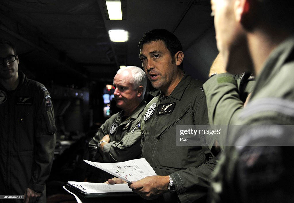 Royal New Zealand Air Force Tactical Coordinator Brent Collier briefs the crew aboard a P3 Orion maratime search aircraft before takeoff towards the...
