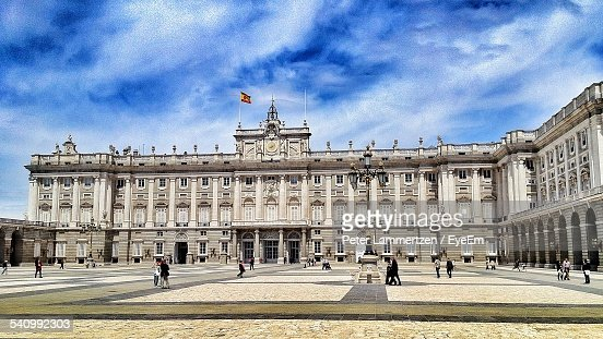 Royal Palace Of Madrid Against Cloudy Sky