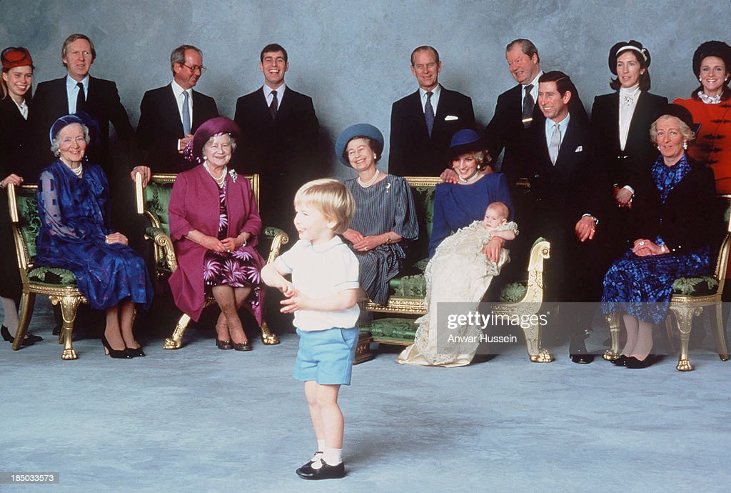 Surrounded by Royal relatives and godparents who are amused at the antics of young Prince William Prince Harry is christened at Windsor Castle on...