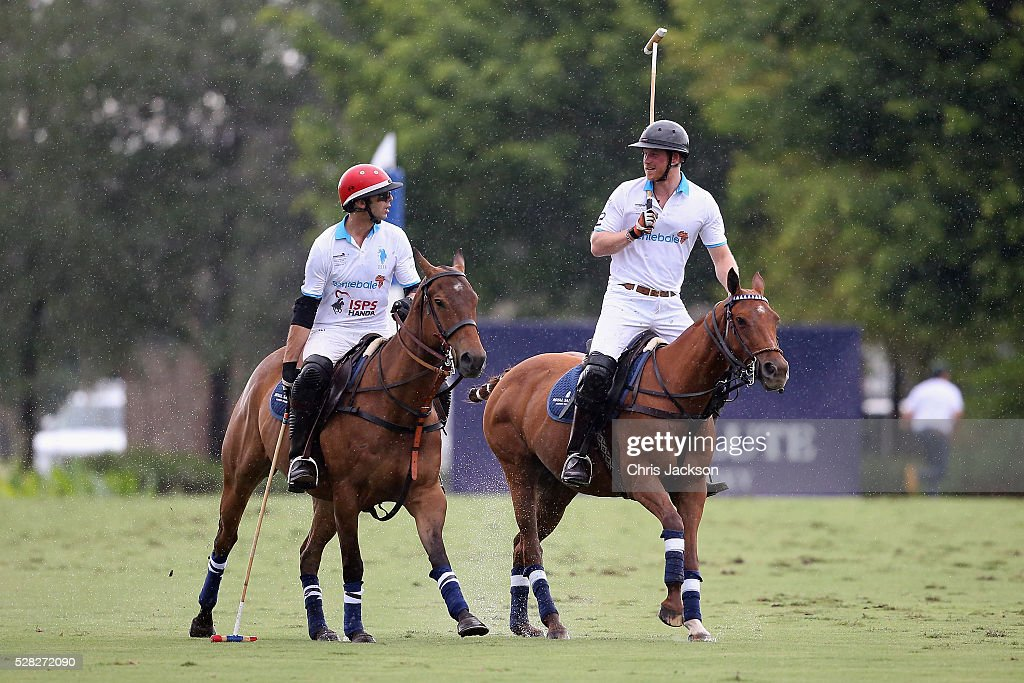 Royal Salute World Polo Ambassador Malcolm Borwick (L) and Prince Harry compete during the Sentebale Royal Salute Polo Cup in Palm Beach at Valiente Polo Farm on May 4, 2016 in Palm Beach, United. The event will raise money for Prince Harry's charity Sentebale, which supports vulnerable children and young people living with HIV in Lesotho in southern Africa.