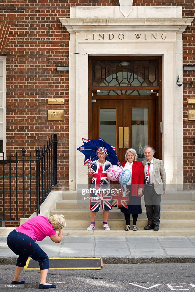 Royal supporter Terry Hutt (2L) and self-proclaimed 'Loyalest Royalist' Margaret Tyler (2R) pose for a photograph outside the Lindo Wing of Saint Mary's Hospital in London, on July 15, 2013, where Prince William and his wife Catherine's baby will be born. The hospital is ready, the Wikipedia page and Twitter accounts are up and Britain's famously creative press are running out of ideas. But Sunday arrived with no sign of the royal baby.
