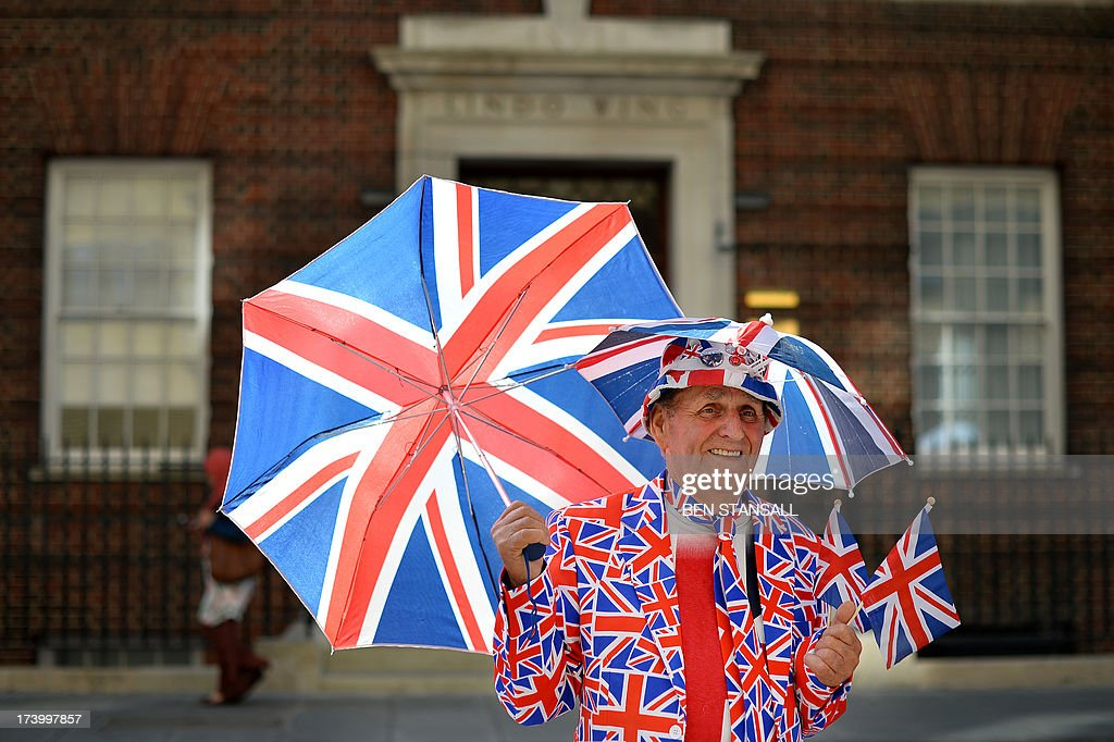Royal supporter Terry Hutt poses for pictures outside the Lindo Wing of St Mary's Hospital in London, on July 19, 2013, where Prince William and his wife Catherine's baby is expected to be born. The long wait for the birth of Britain's royal baby is record business for bookmakers, as punters worldwide bet on a girl called Alexandra to be born any day now. AFP PHOTO / BEN STANSALL