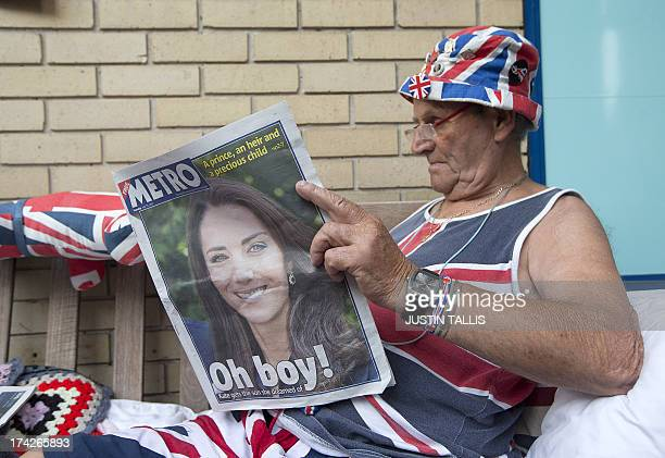 Royal Supporter Terry Hutt reads a newspaper announcing the birth of the newest member of Britain's royal family outside St Mary's Hospital in London...