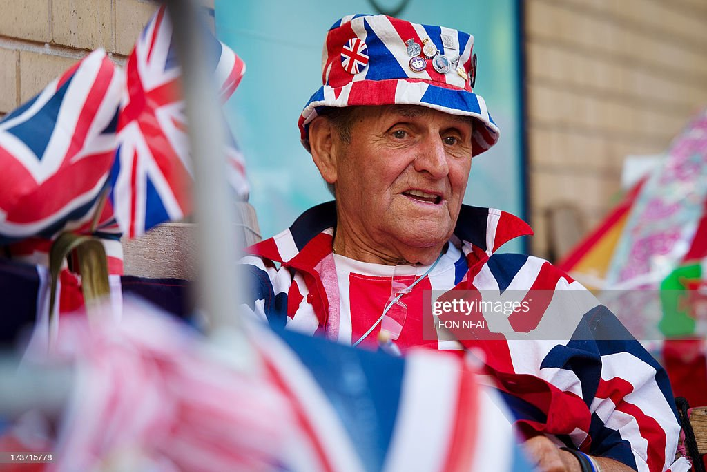Royal supporter Terry Hutt sits among Union flags outside the Lindo Wing of St Mary's Hospital in London, on July 17, 2013, where Prince William and his wife Catherine's baby is expected to be born. Britain's Prince Charles joked Monday that his son Prince William's baby was 'hopefully' on the way, but wife Camilla went further, saying it could arrive 'by the end of the week'.