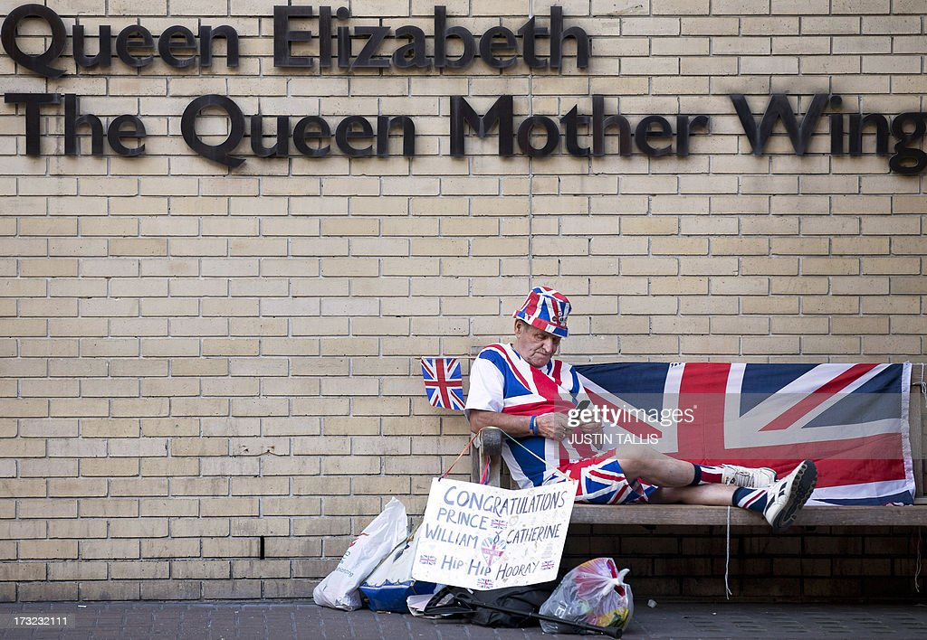 Royal supporter Terry Hutt sits on a bench looking at his mobile phone in front of the Queen Elizabeth, The Queen Mother Wing, directly opposite The Lindo Wing of Saint Mary's Hospital in London on July 10, 2013. Prince William and his wife Catherine's baby, which will be third in line to the throne, will be born in the private Lindo wing of St Mary's Hospital, where William was born in 1982 and his brother Harry in 1984.