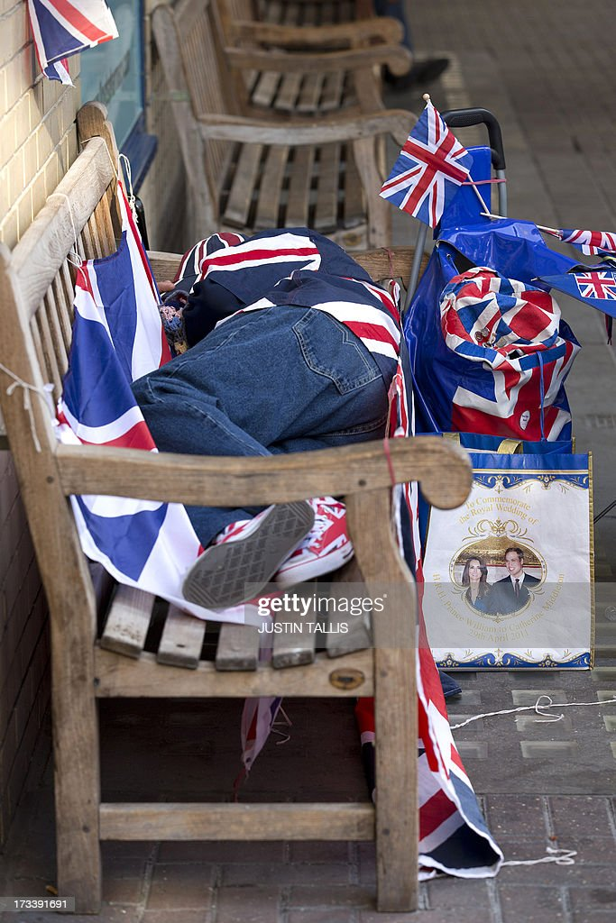 Royal supporter Terry Hutt sleeps on a bench outside the Lindo Wing of St Mary's hospital in London, on July 13, 2013, where Prince William and his wife Catherine's baby will be born. Britain's royal family and the world's media are on tenterhooks awaiting the birth of Prince William and wife Catherine's first child, a baby who will one day be king or queen of Britain and a diverse group of commonwealth countries.