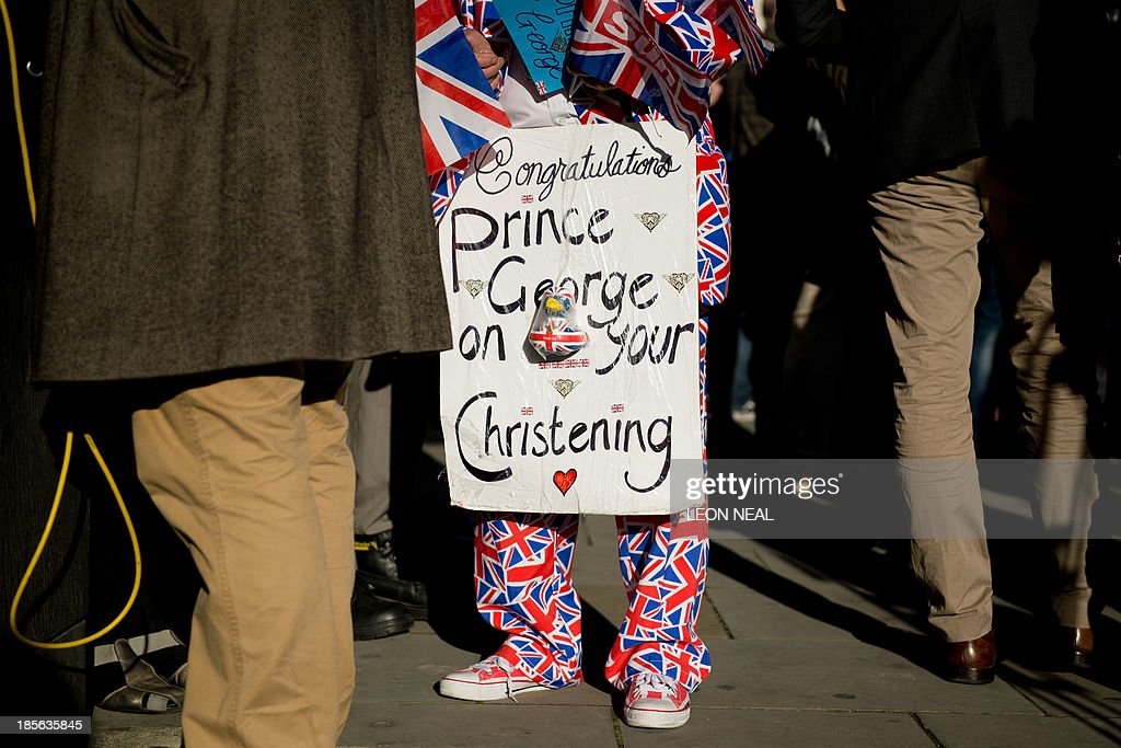 Royal supporter Terry Hutt waits opposite St James's Palace in central London on October 23, 2013, as Prince George of Cambridge is baptised inside Chapel Royal. Prince William and his wife Catherine gather close friends and family for the christening of their baby son Prince George, in a low-key ceremony far removed from the global hype surrounding their wedding. AFP PHOTO/LEON NEAL