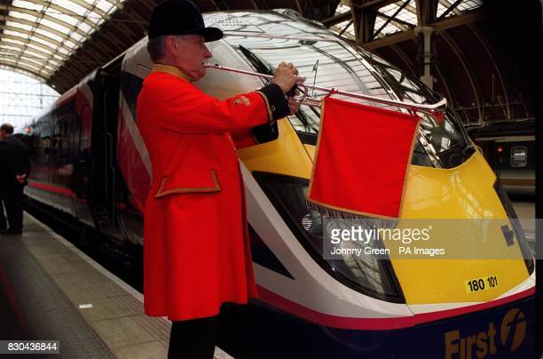 Royal Thames trumpeter John Gummer plays at London Paddington station to mark the arrival of the first new high speed train to enter a London station...