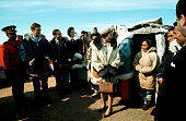 Royal visit to NWT 1970 Queen Elizabeth speaks to an Inuit woman Clad in a blue parka Jean Chretien Minister of Indian Affairs looks on