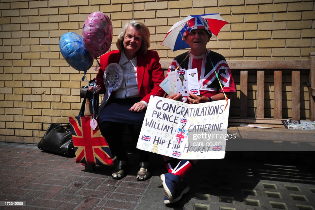 Royal well-wishers wait outside the Lindo Wing of Saint Mary's Hospital in London, on July 12, 2013, where Prince William and his wife Catherine's baby will be born. Britain's royal family and the world's media are on tenterhooks awaiting the birth of Prince William and wife Catherine's first child, a baby who will one day be king or queen of Britain and a diverse group of commonwealth countries.