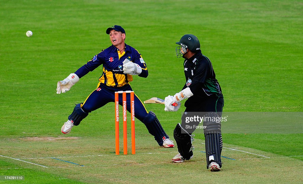 Royals batsman Thilan Samaraweera hits out watched by keeper Mark Wallace during the Friends Life T20 match between Glamorgan Dragons and...