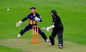 Royals batsman Thilan Samaraweera hits out watched by keeper Mark Wallace during the Friends Life T20 match between Glamorgan Dragons and...