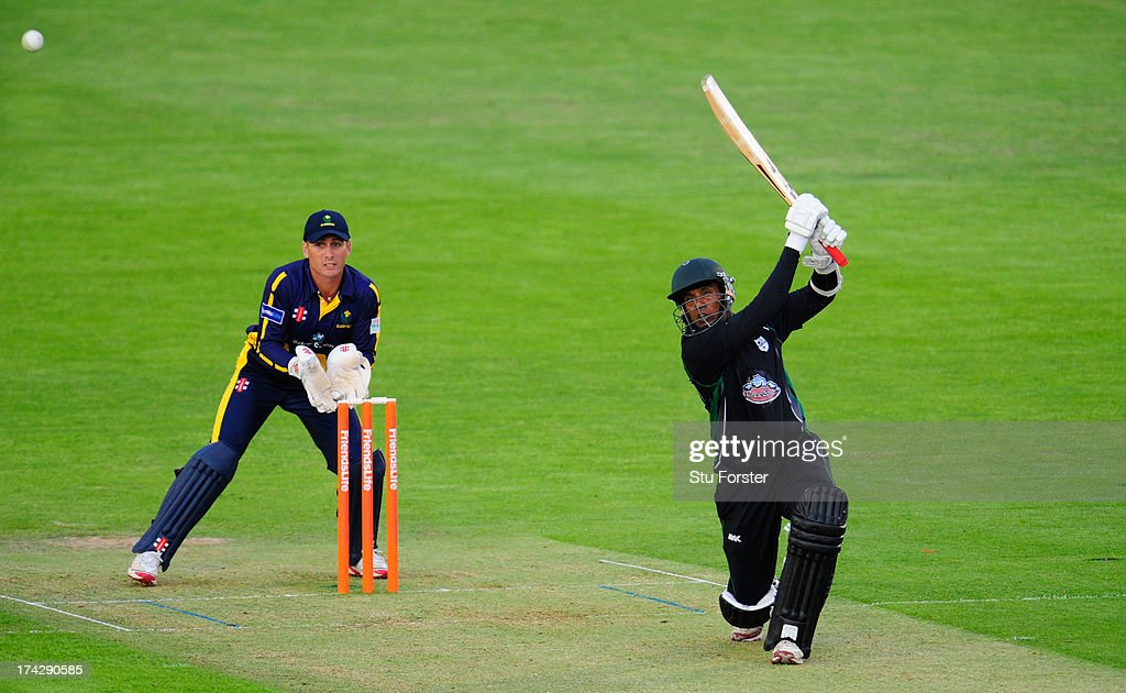 Royals batsman Thilan Samaraweera hits over the top watched by keeper Mark Wallace during the Friends Life T20 match between Glamorgan Dragons and Worcestershire Royals at SWALEC Stadium on July 23, 2013 in Cardiff, Wales.