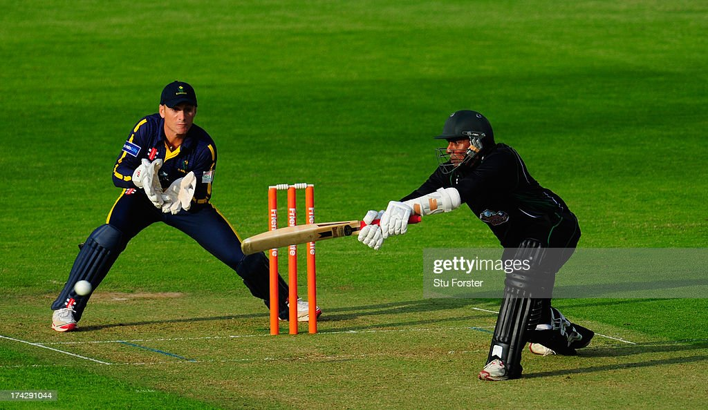Royals batsman Thilan Samaraweera hits over the top watched by keeper Mark Wallace during the Friends Life T20 match between Glamorgan Dragons and...