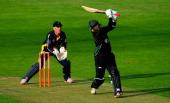 Royals batsman Thilan Samaraweera hits over the top watched by keeper Mark Wallace during the Friends Life T20 match between Glamorgan Dragons and...