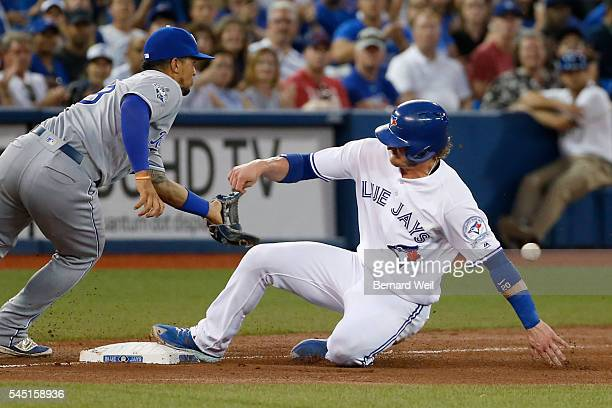TORONTO ON JULY 5 Royals' Cheslor Cuthbert makes a late catch as Jays' Josh Donaldson is safe at 3nd base off a Michael Saunders single in the 7th...