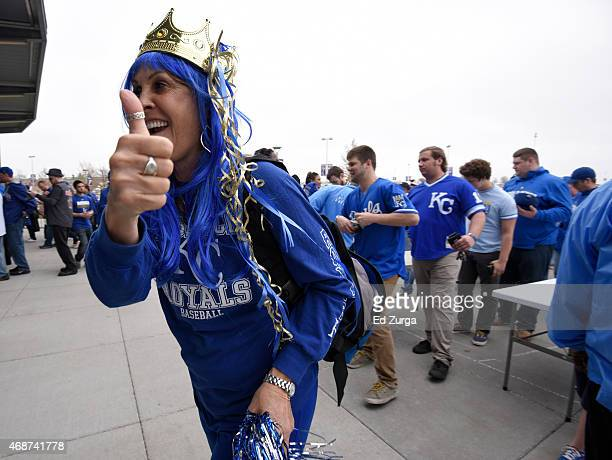 Royals fans gives a thumbs up as she enters Kauffman Stadium for the opening day game between the Chicago White Sox and Kansas City Royals on April 6...