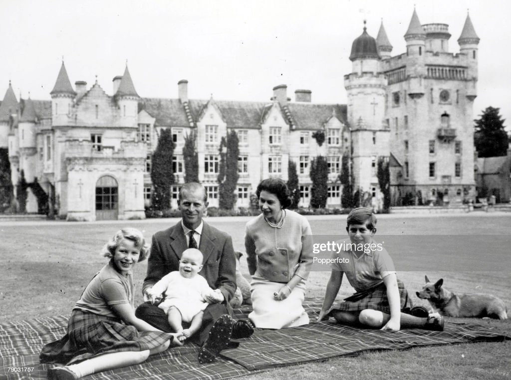 Royalty, 9th September 1960, During their holiday on the Balmoral Castle estate the Royal family sit together within the grounds, a happy smiling baby Prince Andrew held on his father the Duke of Edinburgh+s lap, Pictured also smiling is Queen <a gi-track='captionPersonalityLinkClicked' href=/galleries/search?phrase=Elizabeth+II&family=editorial&specificpeople=67226 ng-click='$event.stopPropagation()'>Elizabeth II</a> with <a gi-track='captionPersonalityLinkClicked' href=/galleries/search?phrase=Princess+Anne+-+Princess+Royal&family=editorial&specificpeople=11706204 ng-click='$event.stopPropagation()'>Princess Anne</a> and <a gi-track='captionPersonalityLinkClicked' href=/galleries/search?phrase=Prince+Charles&family=editorial&specificpeople=160180 ng-click='$event.stopPropagation()'>Prince Charles</a> and their Corgi dogs that are with them also