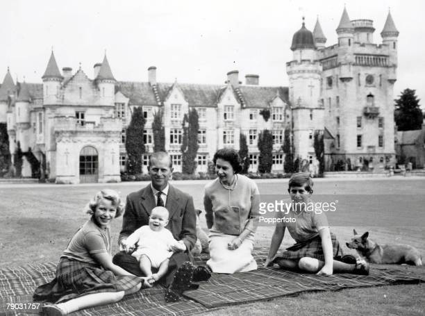 Royalty 9th September 1960 During their holiday on the Balmoral Castle estate the Royal family sit together within the grounds a happy smiling baby...