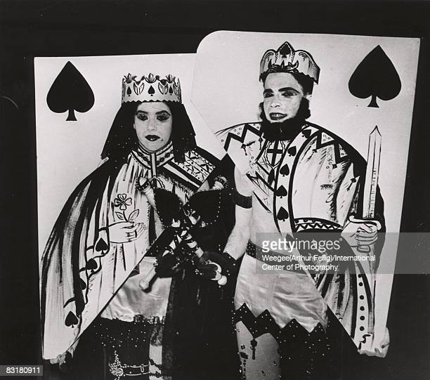 Royalty comes to the Artists Equity Association's Masquerade Ball as a man and woman dressed as the King and Queen of Spades display their sharp...
