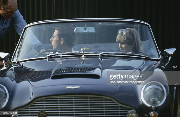 Royalty England Circa 1981 Prince Charles and girlfriend Lady Diana Spencer leaving a Polo match in Charles' Aston Martin sports car
